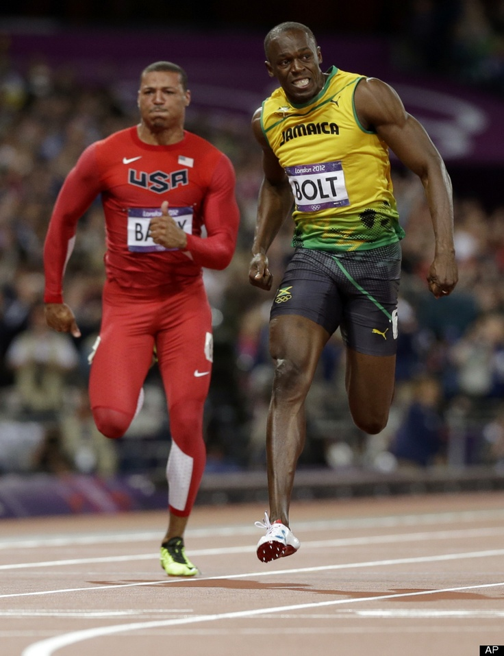 Jamaica's Usain Bolt, right, leads United States' Ryan Bailey in the men's 100-meter final during the athletics in the Olympic Stadium at the 2012 Summer Olympics, London, Sunday, Aug. 5, 2012.(AP Photo/Anja Niedringhaus)