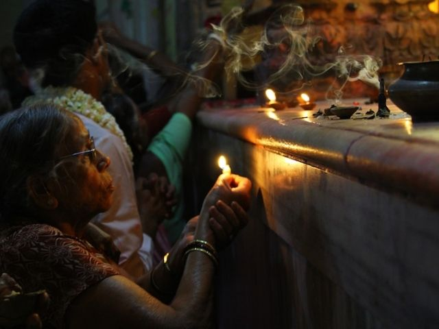 Lamp offering at the Radha-Ramana temple. Vrindavan, India