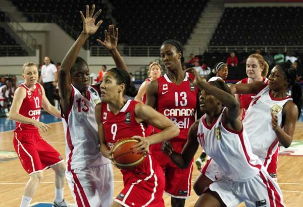 Canada's Miranda Joy Ayim goes for a basket against Mali's Aminata Traore (L) and Farima Toure (R) during their 2012 women's FIBA Olympic Qualifying Tournament in Ankara June 25, 2012.: Farima Toure, Joy Ayim, Ankara June, Canada S Miranda, June 25, Fiba Olympic, 2012 Women S