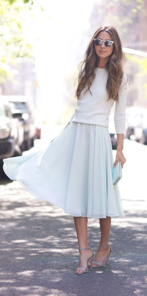 Women's fashion | White sweater, pastel blue pleated dress, grey heels and a clutch