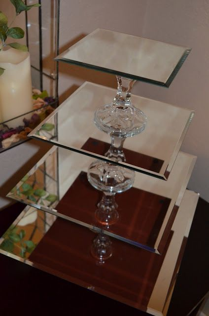 Cupcake Stands out of mirrors and candlesticks!<<< If it were me, I would use Chrome spray paint on the candlesticks...