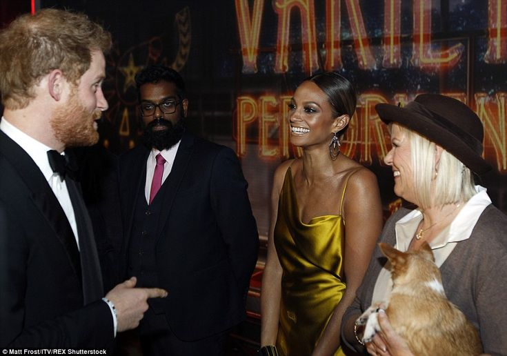 Britain's Got Talent judge Alesha Dixon - looking resplendent in a golden silk gown - was seen smiling at Prince Harry, who appeared to be pointing at her outfit