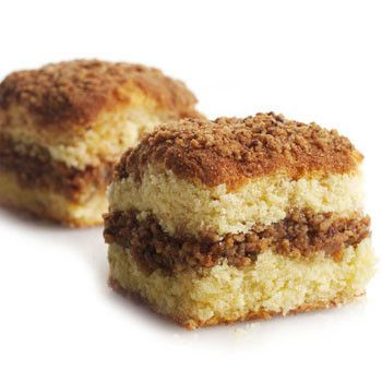 This cake is a little different from our traditional crumb cake. A rich walnut filling through the middle separates two layers of rich, buttery cake. Those three layers are then topped with an irresis