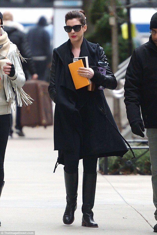 Anne Hathaway is movie star chic in black ensemble with dark shades #dailymail