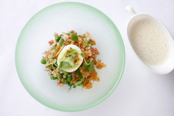 Dovetail's Brand-New Dishes Are Michelin-Caliber Riffs on Time-Honored Classics. Soft-boiled egg, chicken cracklings, sugar snap peas, and barley.