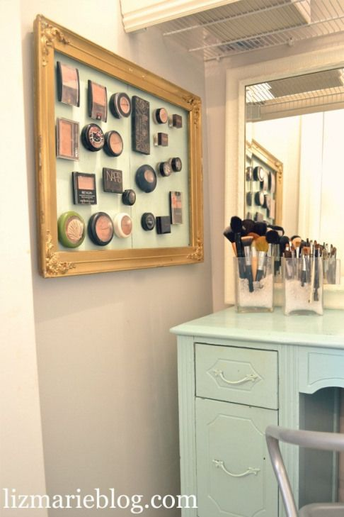 Glue magnets onto the back of your makeup cases and stick to a framed piece of metal!!  I love all the variations of this idea.