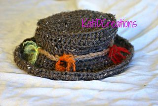 """Fishing hat with cute little """"lures"""" around the band.  FREE CROCHET PATTERN @ Ravelry"""