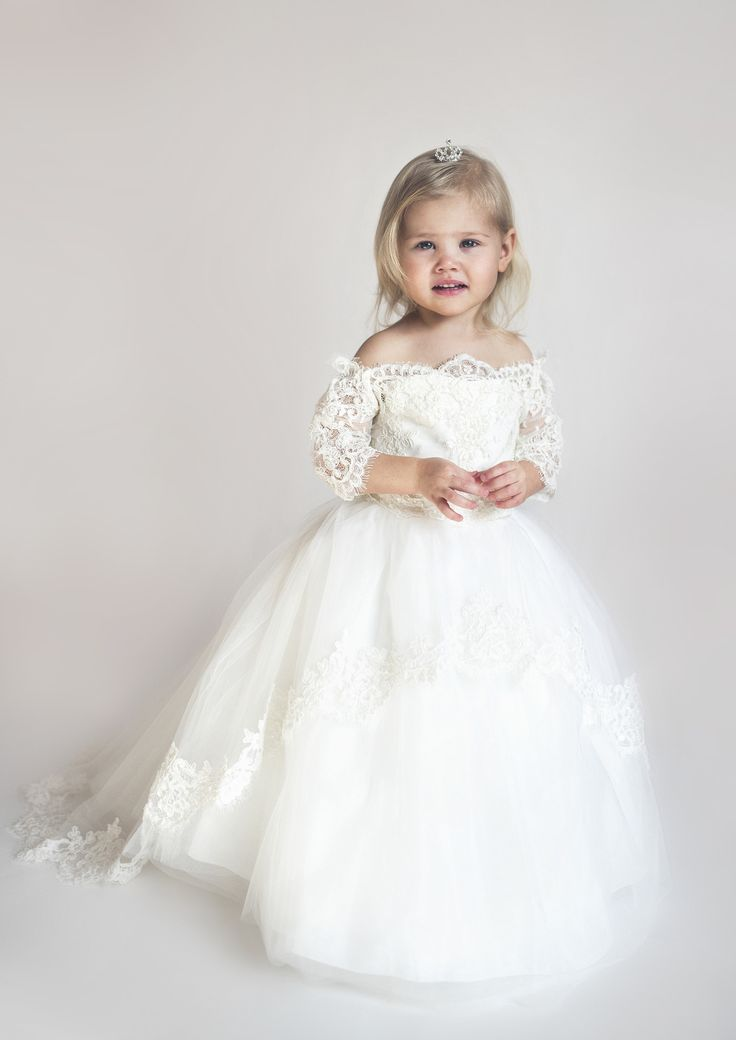 Adorable Off-The-Shoulder Christening Dress. Adorable off-the-shoulder Christening dress with train perfect for her baptism. Features 3/4 lace sleeves and lace neckline. This beautiful little girls dr