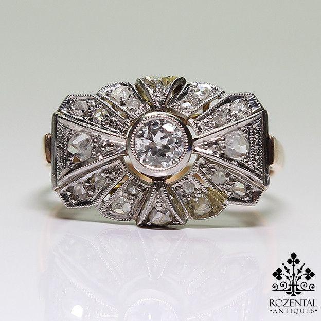 Period: Art deco (1920-1935) Composition: 18K Gold & Platinum. Stones: - 1 Old mine cut diamond of H-VS2 quality that weighs 0.30ctw. - 18 Rose cut diamonds of I-SI1 quality that weigh 0.30ctw. Ring s