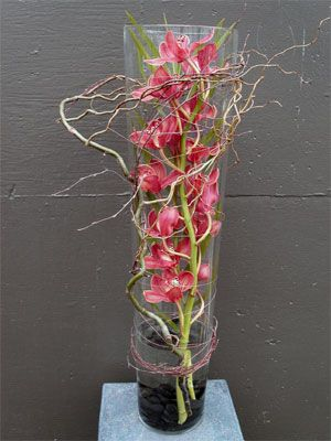 love the branches attached to the outside of the vase with thin wire