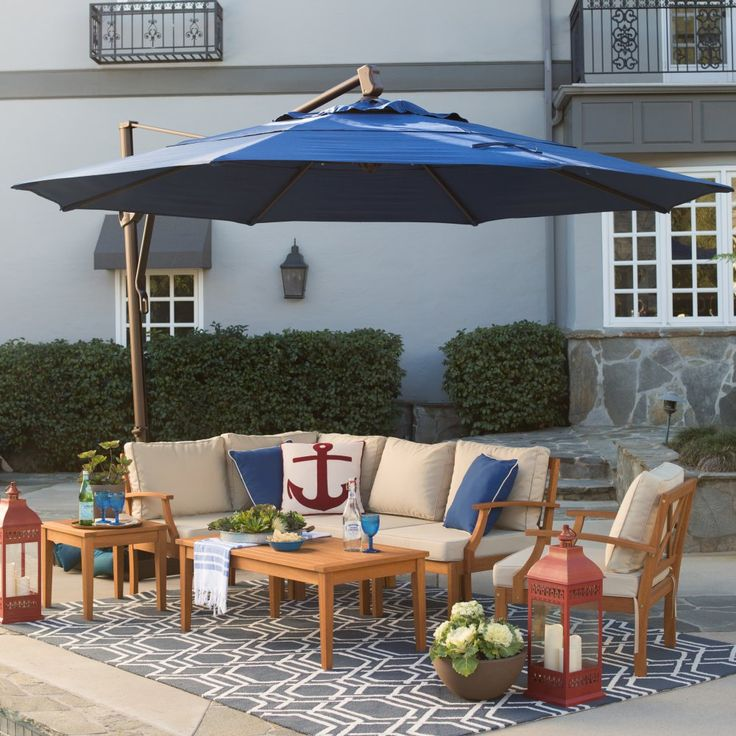 Belham Living Sunbrella 13-ft. Rotating Offset Umbrella with Tilt and Base - With its sleek bronze finish and handy offset design, the Coral Coast 13 ft. Rotating Offset Umbrella with Tilt will cast a comfortable shade over you...