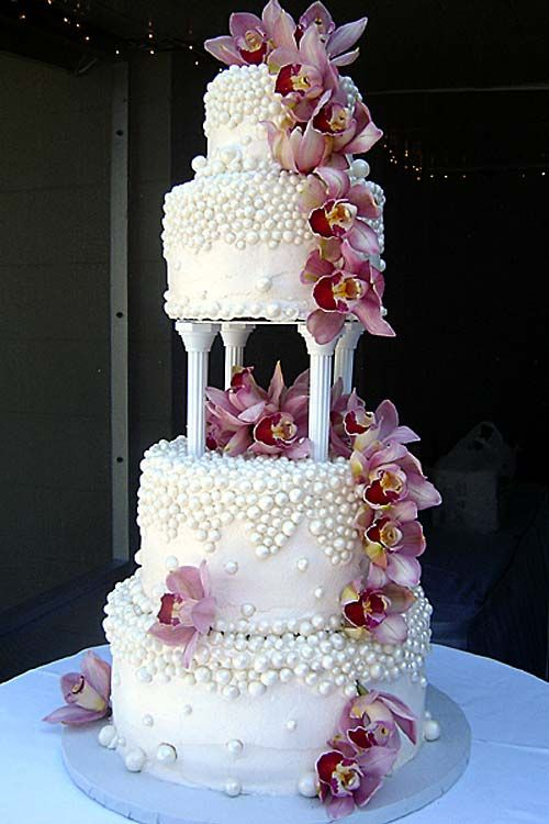 Huge gorgeous four tier round shaped wedding cake garnished with pink Cymbidium Orchids and white bubble shaped balls. From www.annettescakes.com        ........   #wedding #cake #birthday