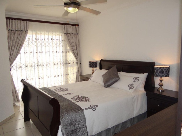 A beautifully decorated main bedroom in a holiday apartment on the beachfront in Margate