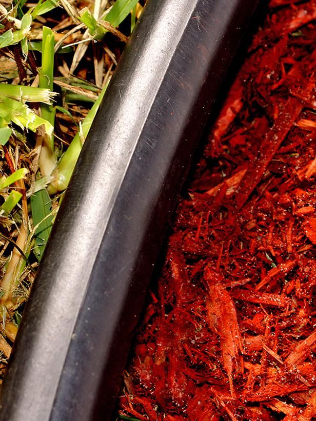 """Choose Edging Type: Solid There are many varieties of edging, but most fall into two categories. The first is a solid length of edging that comes in a roll. It could be made of metal, rubber or plastic and is usually black or brown. However, landscape architect Maureen Smith says, """"Metal or rubber edging is more likely to crack or chip, particularly when it takes abuse from lawn equipment."""""""