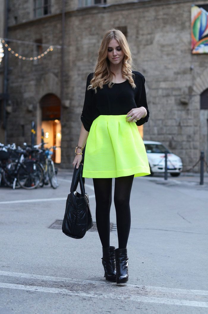 neon yellow skirt with black top