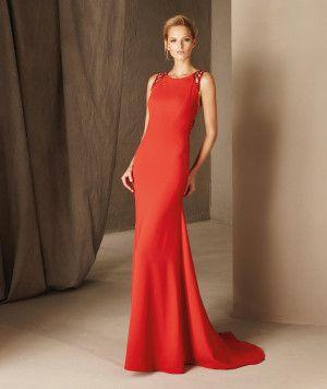 Brisa— вечернее платье силуэта «русалка», созданное из тюля и крепа, с круглым вырезом.