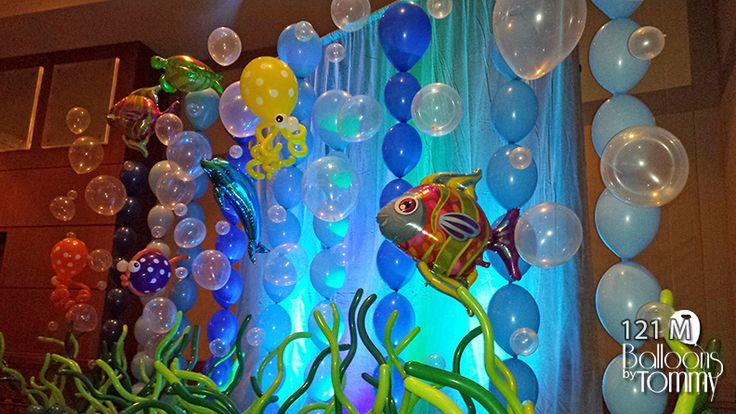 examine closely-balloons hung from monofilament--- see fish and octopus made from balloons
