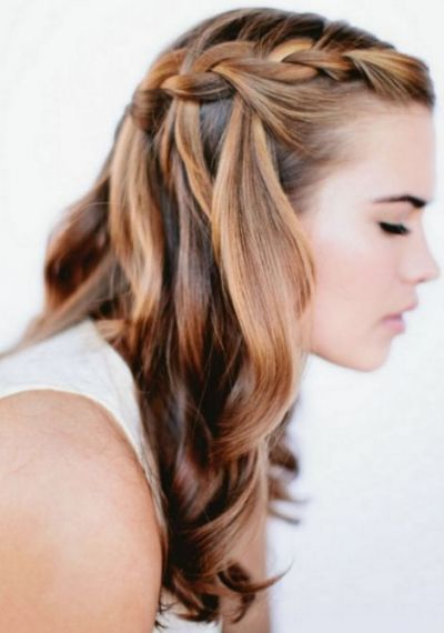 Waterfall braids are simply gorgeous especially when done right as seen in this picture starting from the front flowing loosely to the back, contrary to what many women believe they are quite easy to achieve it just takes a little practice we suggest
