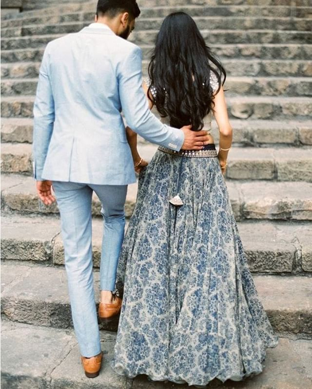 His crisp blue suit and her lehenga-inspired outfit are the perfect mix of East and West; traditional and modern. Head over to Once Wed for this and more multicultural wedding inspiration. Image: @erichmcvey   Creative Direction & Styling: @ginnyau You can learn more about Erich and Ginny's proccesses via their online courses with @ifimade. #multiculturalwedding #oncewedstyle #weddingphotography #ifimade #processdrivendesign