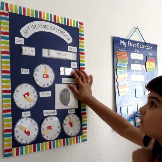 """Children's Islamic Calendar We love using an Islamic calendar in our homeschool. Teaching the Islamic months is an important part of any Muslim homeschool, and we use ours during """"Calendar Time"""" in the morning. I have been looking online for an interactive calendar for the kids with inter-changeable Islamic months, lunar cycle and prayer times. …Read more..."""