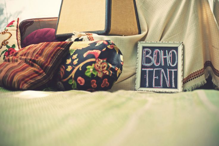 Boho tent, bohemian wedding, chalkboard frame, cushions, Moroccan tent, wedding styling. Ashley + Devon's Whimsical Boho Wedding | Kismet & Clover {http://kismetandclover.com}