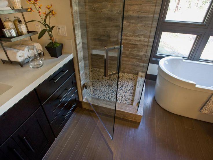NS...Freestanding bathtub.  Dark cabinets.  Light stone countertop.  Seamless glass shower door.  Pebble floor in shower.
