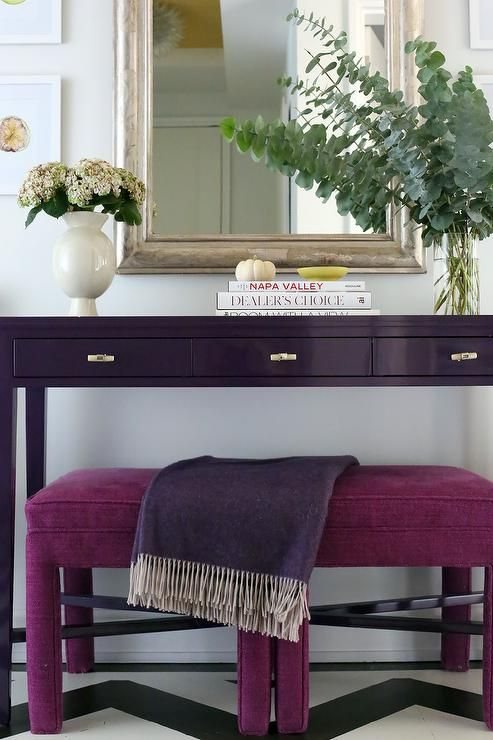 Purple Themed Foyer Boasts A Silver Leaf Mirror Hung Above A Purple  Lacquered Console Table Positioned