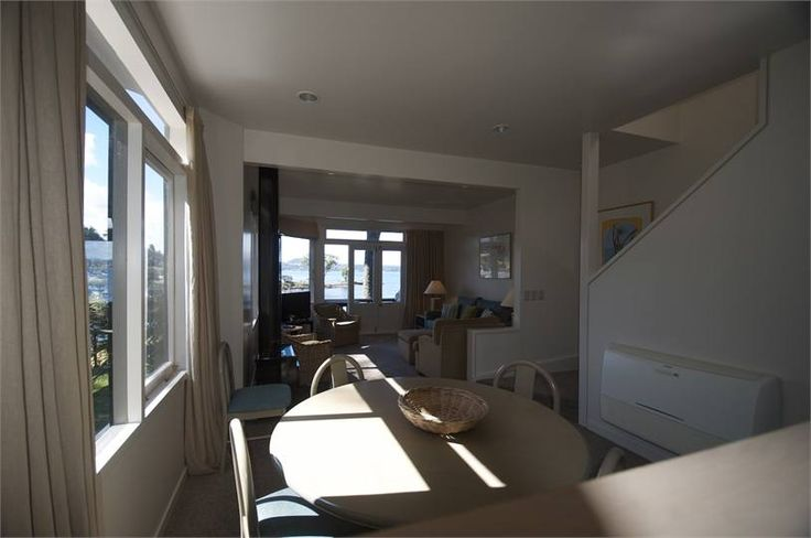 The two storey cedar chalets comprise two double bedrooms upstairs, each with its own modern en suite bathroom. The open plan living area, balcony, dining room and kitchen provide panoramic lake views...