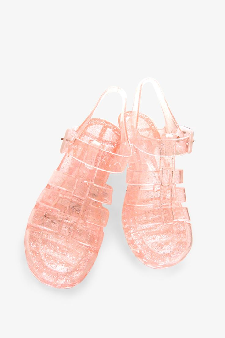This item is shipped in 48 hours, including the weekends. These clear roman style sandals are perfect for hitting the beach or the pool. With their open work design they are great on sandy beaches and