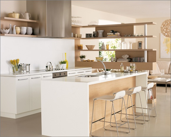 The lower cupboards are finished in Laminex ColourTech Gloss doors in Polar White - Classic Profile for a sleek finish.    The island bench, slab ends, galley top and splashback are made from Essa Stone in PURITY.