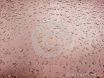 Textured background with water drops on the brown window