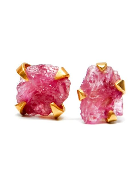 Icy, translucent chunks of watermelon pink tourmaline rest inside an organic prong setting in brushed gold vermeil.