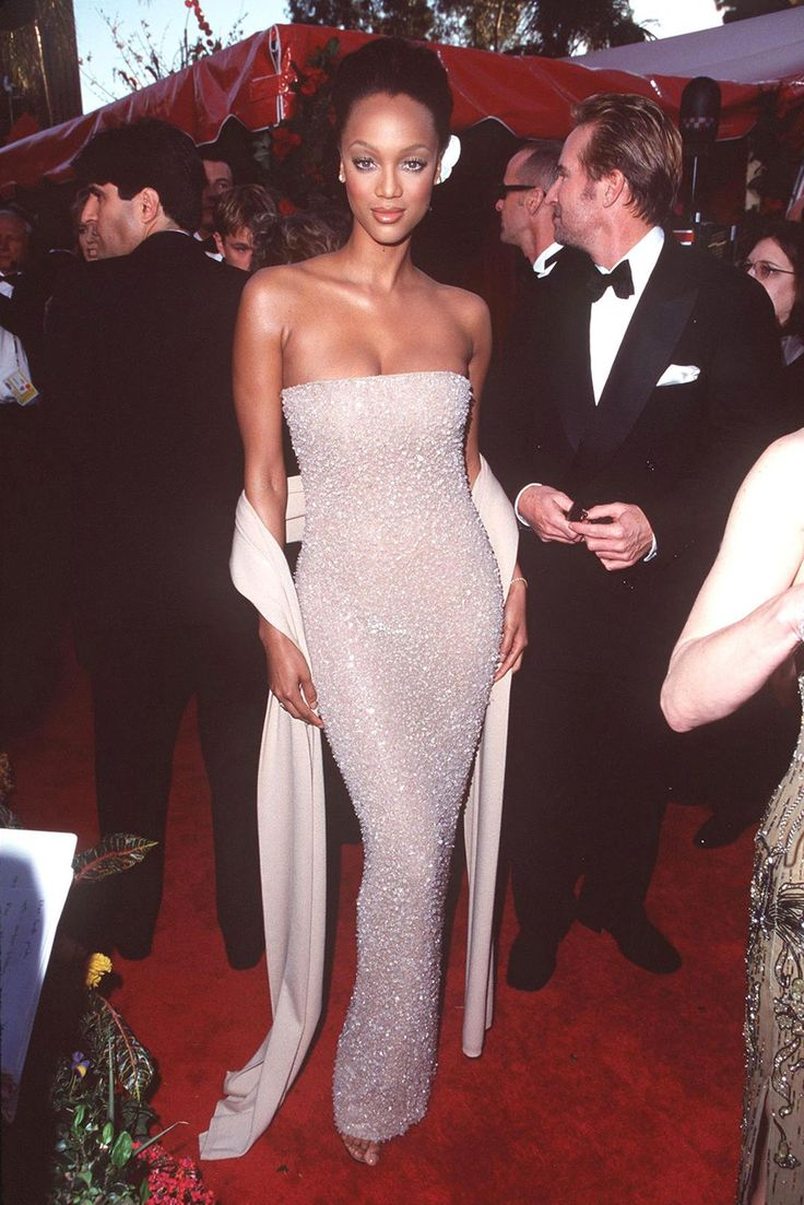 Tyra Banks, Our '90s Rihanna-In-Training #refinery29  http://www.refinery29.com/tyra-banks-lookbook-throwback-90s-fashion#slide-3  At the 70th Academy Awards, she rocked a strapless column dress and coordinating sash. Bring back the sash! ...