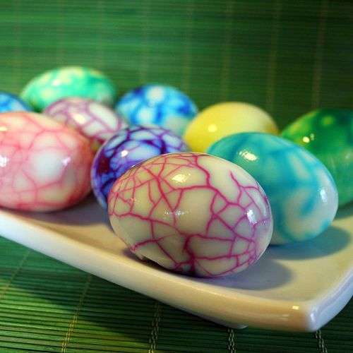 Easter eggs:  1. Boil eggs.  2. Crack shell.  3. Dip in colored water (food color)  4. Peel shell off.