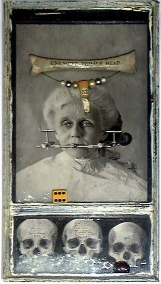 Unknown Female Head by Keith Lo Bue Basswood, glass, die, marble, crushed glass, photo-lithograph (1880), deer bone, brass wire, beads, vial, crab claw, mirror,paint, paper, text