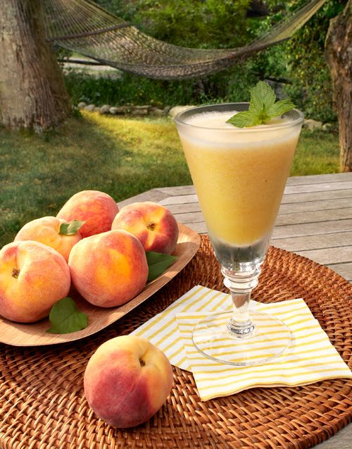 *Perfect Peach Daiquiri - 1 magnificent tree-ripened peach, peeled, pitted  and cut up, 1 cup crushed ice, 2oz. golden rum.