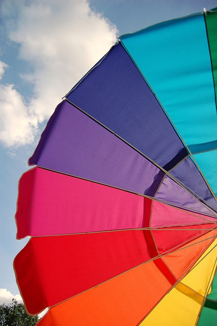 giant rainbow umbrella - catches attention and protects from sun and rain!