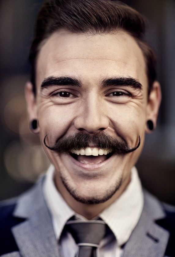 Simple handlebar mustache with thin and rolling ends