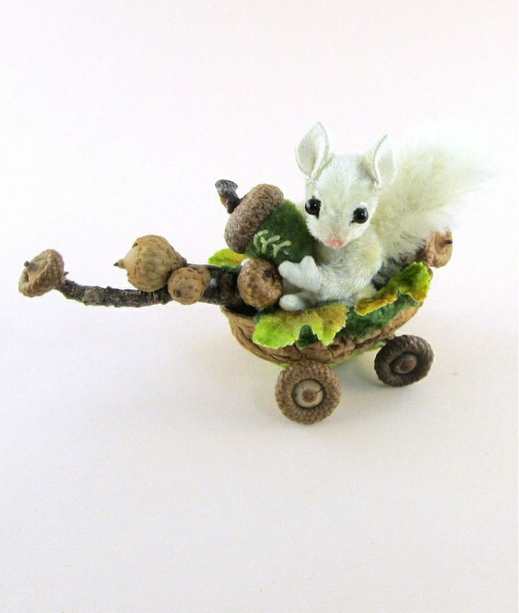 OOAK 2013 Janie Comito ~ Fully Jointed Snowy White Squirrel in Acorn Nut Cart Recently Janie was browsing the internet when she came across a National Geographic piece about some white squirrels who inhabit the town of Marionville MO. According to the article, it's something of a mystery how they came there. Janie loves little furry creatures