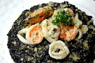 Risotto black ink with calamari, prawns and mussels at Bacchus Wine Bar & Restaurant