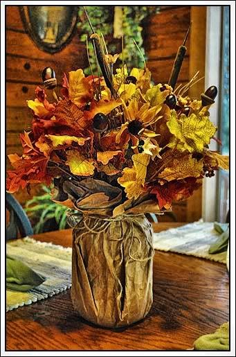 Very inexpensive fall decor--paper sack, canning jar, and silk flowers...could use burlap maybe instead of paper sack?? Use cans instead of canning jars?