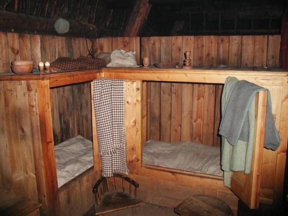 The box beds were the only means of privacy in these homes. They usually had either doors or a curtain to pull over the front. Several people would sleep in the beds head to foot to keep warm. The bed consisted of a linen mattress filled with straw.