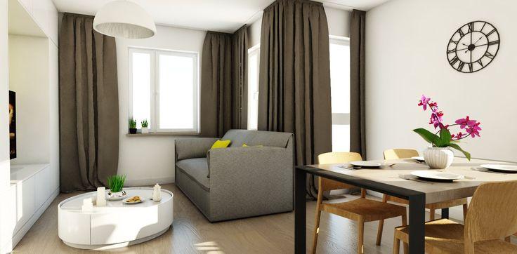 Salon z kuchnią i strefą  wypoczynkową. Nowoczesna kanapa, która może pełnić funkcję wygodnego siedziska do oglądania telewizji, a także być miejscem do relaksu w dzień. Funkcjonalny stolik kawowy jest nie tylko praktycznym rozwiązaniem, ale stanowi też designerski element dekoracyjny.