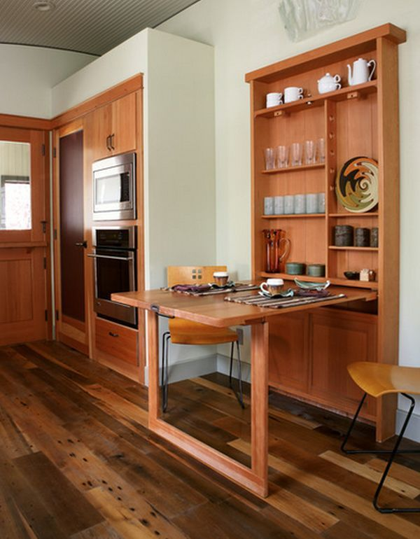 Folding tables are useful in small spaces. They can be hidden and stored and double or triple their surface when unfolded. | How To Maximize The Space In A Small Apartment | Tiny Homes