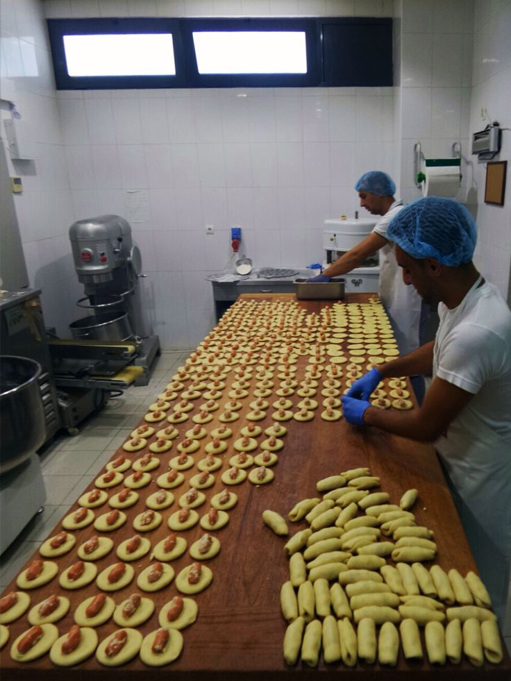 Every single day here, at Lemonis bakery production area, we're preparing delectable kourou mini sausage pies for your breakfast.