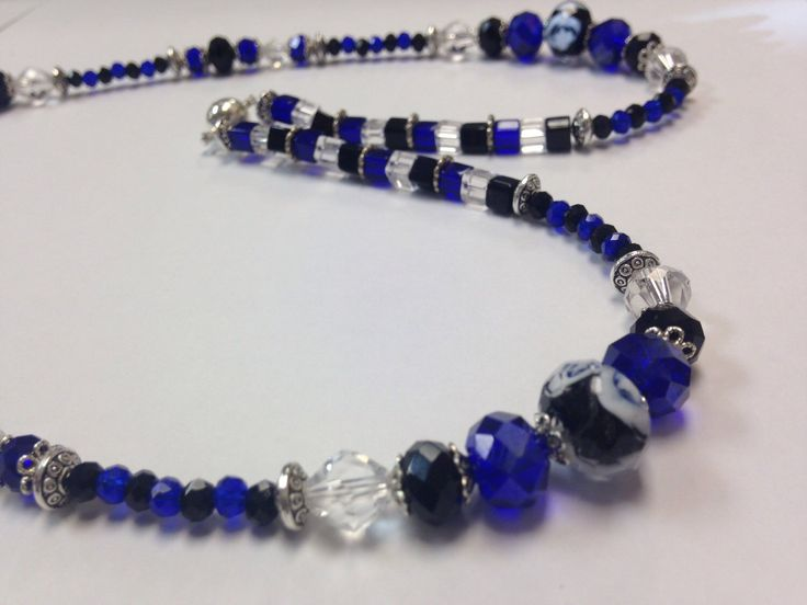 A personal favorite from my Etsy shop https://www.etsy.com/listing/253944103/royal-blue-black-and-clear-lanyard-badge