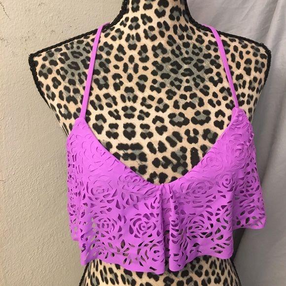 💕NWOT bikini top by Xhilaration💕 Super cute purple cut out bikini top has removable padding and crosses in the back awesome purple Xhilaration Swim Bikinis