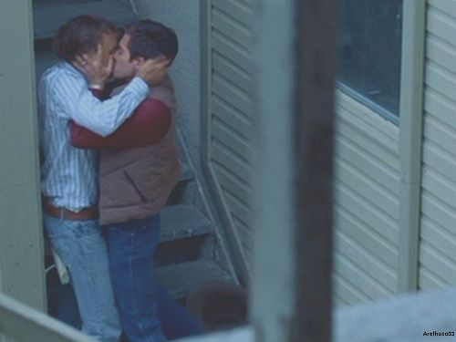 Brokeback Mountain ~ Jack (Jake Gyllenhaal) and Ennis (played by Heath Ledger) steal a moment for a kiss.