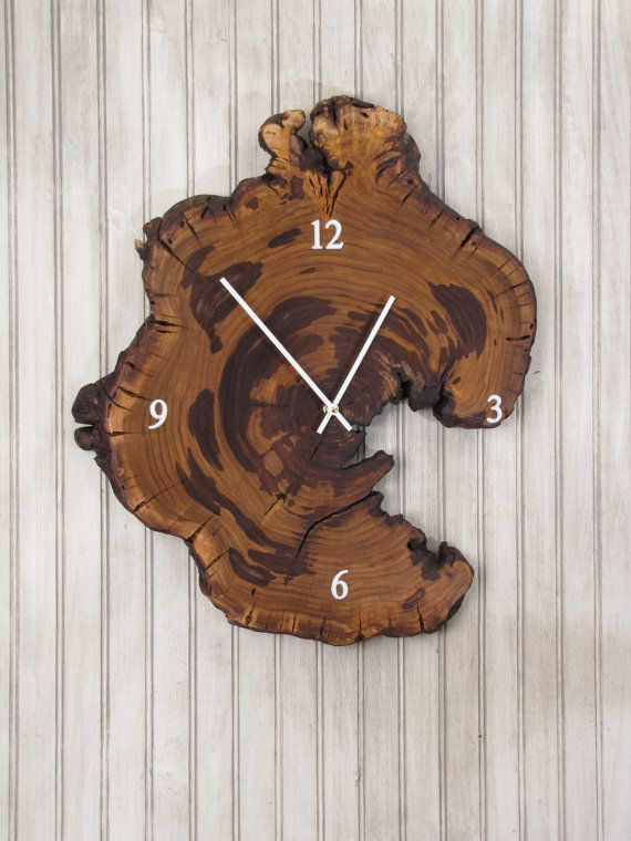 Redbud Wood Clock - Live Edge Reclaimed Tree Slice    This unique and natural clock is made from a live edge slice of a semi-burled redbud tree rescued from tree removal in St. Louis County, Missouri. Redbud is a small tree known for its beautiful pinkish purple buds in the spring and seldom grows to this large size. This one exhibits an odd shape and some very interesting color variations due to its semi-burled nature. This would feel at home in any nature, modern, cabin, or rustic theme…