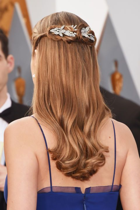 An embellished hair accessory adds a festive touch to any style.